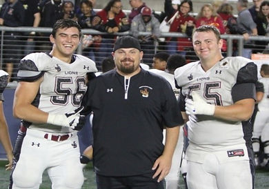 Coach Fisher with Bolduc and Parks.jpg