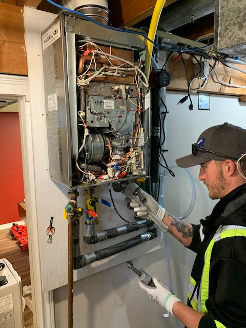 Brian doing a boiler tune up