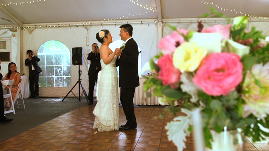 Bride and Groom First Dance with Flowers