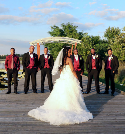 Bride with groomsmen showing back of dre