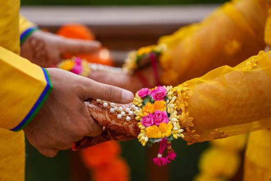 Groom Holding Hands at Haldi