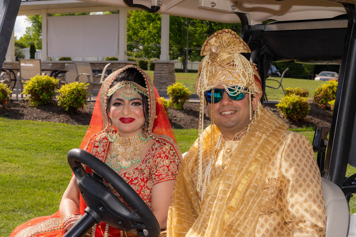 Bride and Groom in Golf Carts