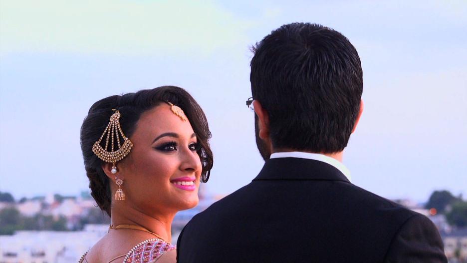 Bride Looking at Husband at Sunset