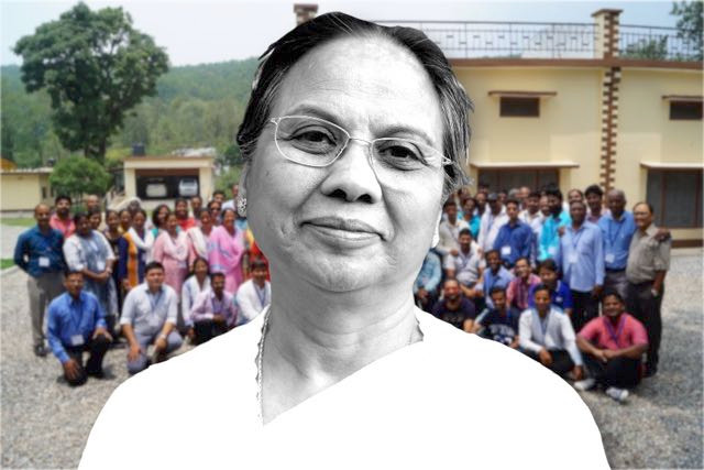 A picture of Madhu with the Uttarakhand Cluster behind