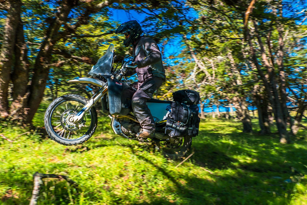 Dave getting some air and skilfully making his way up the slippery, grassy slope through the trees - AvVida.co.uk