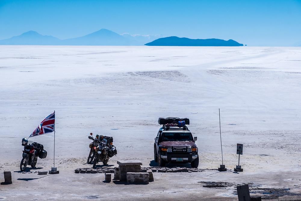 View from Isla Inkahuasi of the vehicles and the bike of the guy we met from the US - AvVida.co.uk