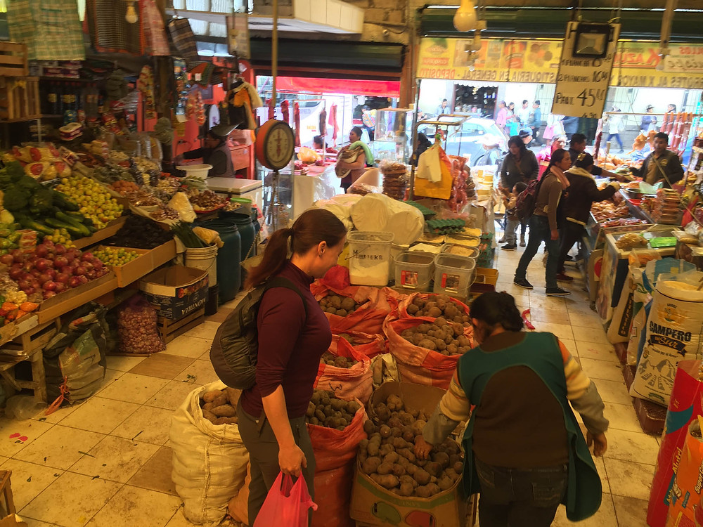 Buying potatoes in Urubamba market.