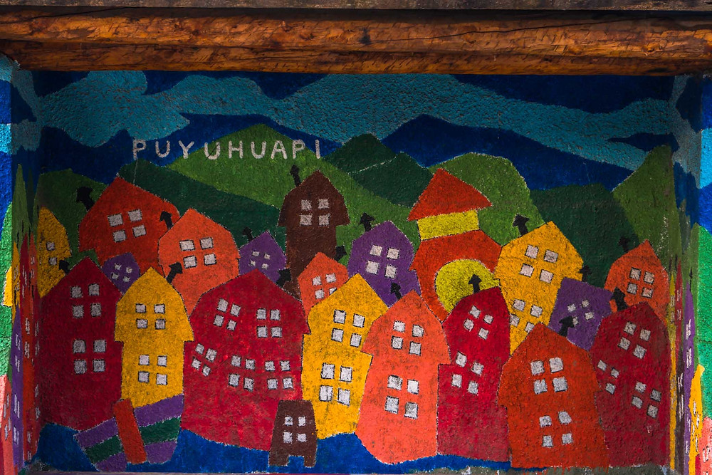 Puyuhuapi colourful painting in the town - AvVida.co.uk