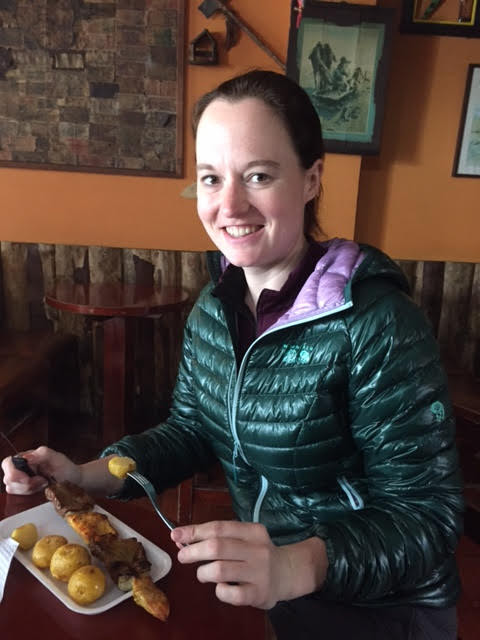 Suzie eating Pinchos pollo y carne