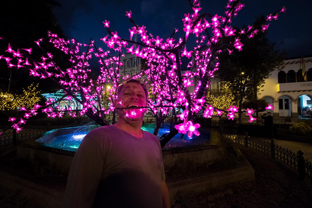 Kelvin having fun in the lights of Cuenca. Photo by Michnus Olivier.