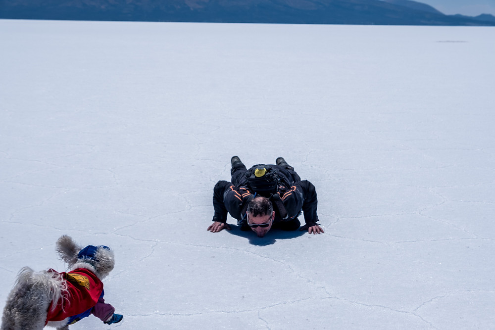 Kelvin licking the salt and Jack running for cuddles on the Bolivia Salt Flats - AvVida.co.uk