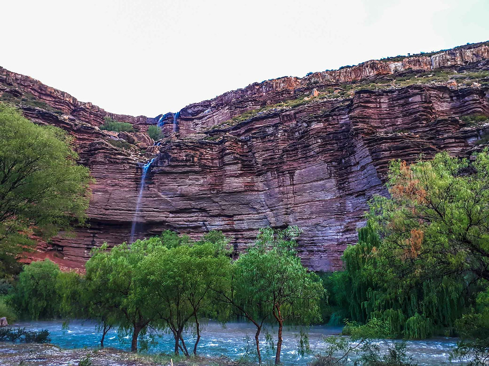 The stunning rock formations, waterfall and river at our campsite - AvVida.co.uk
