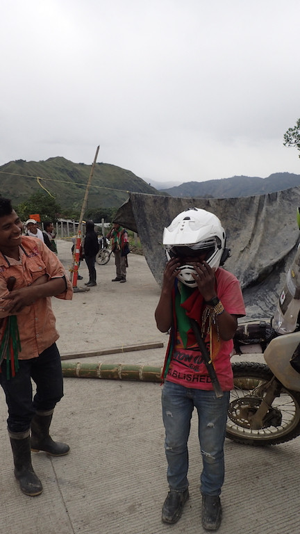 A local boy trying on Kelvin's huge helmet!