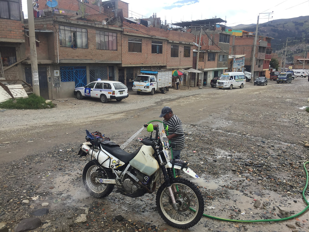 Getting my bike washed ready for some maintenance work on backstreets of Cusco - AvVida.co.uk