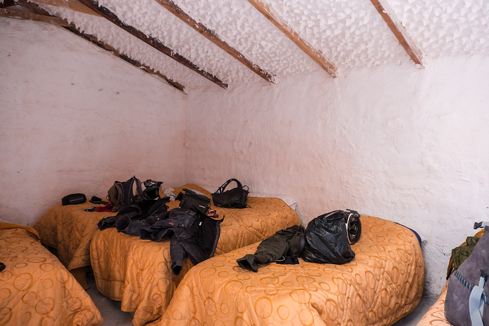 A small room with 5 single beds but better than a tent after 5 days on the Lagunas Route! - photo by www.AvVida.co.uk