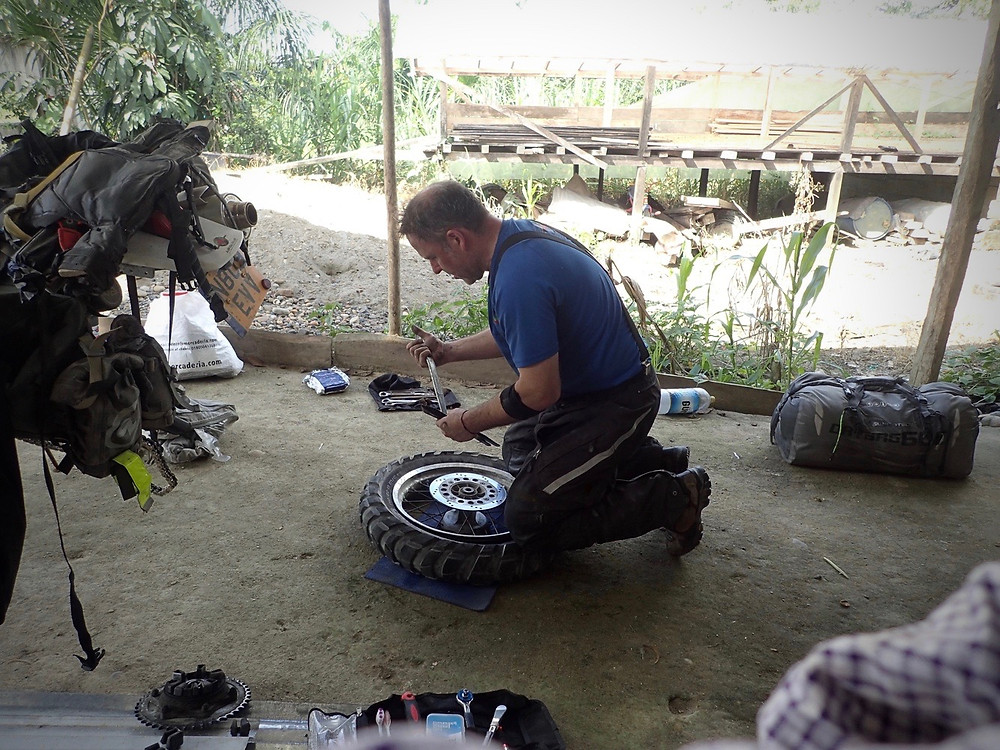 Kelvin working on changing the tyre in the heat.