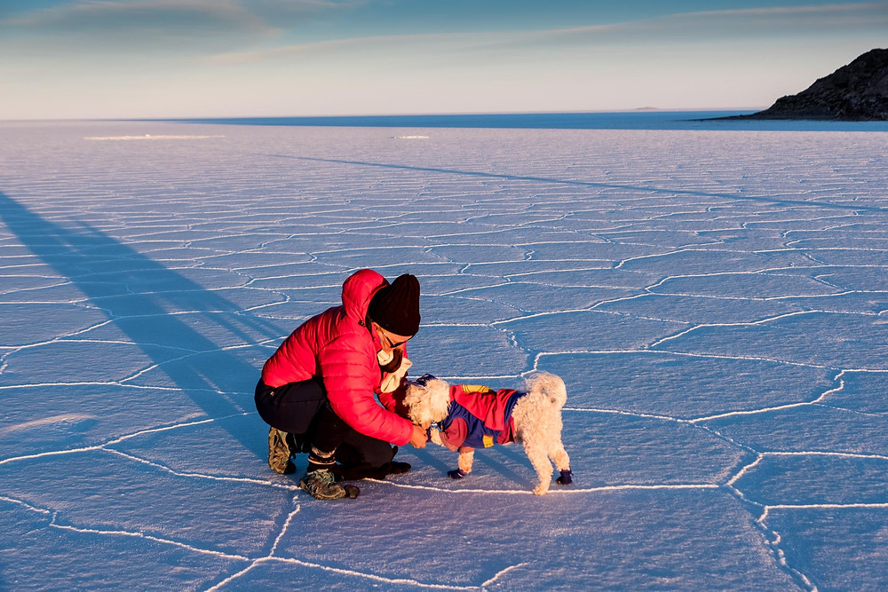 Kirsi securing Jack's booties on the salt flats - AvVida.co.uk