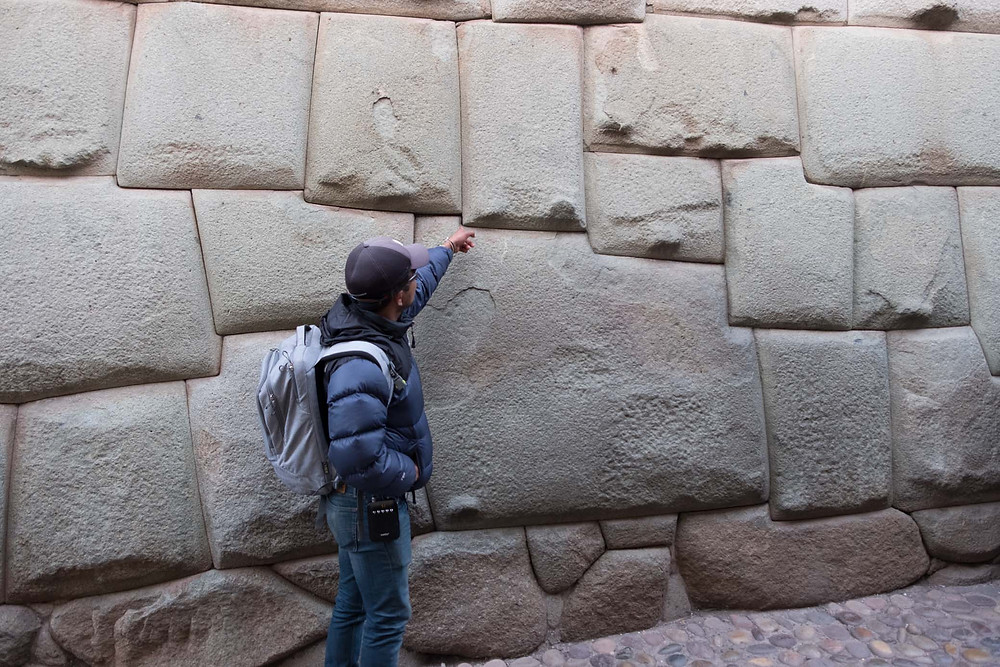 Our guide Marco showing us some Inca stones.  AvVida.co.uk. Photo by Suzie Bostock.