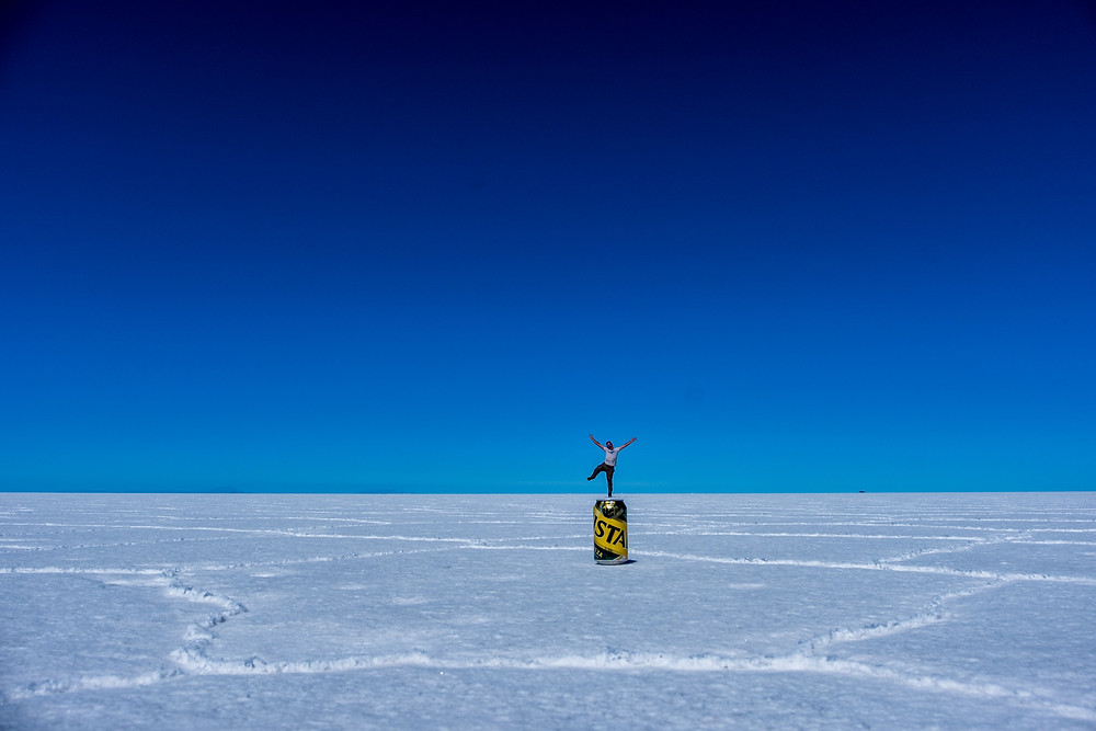 Kelvin standing on a can of Crystal on Bolivia Salt Flats - AvVida.co.uk
