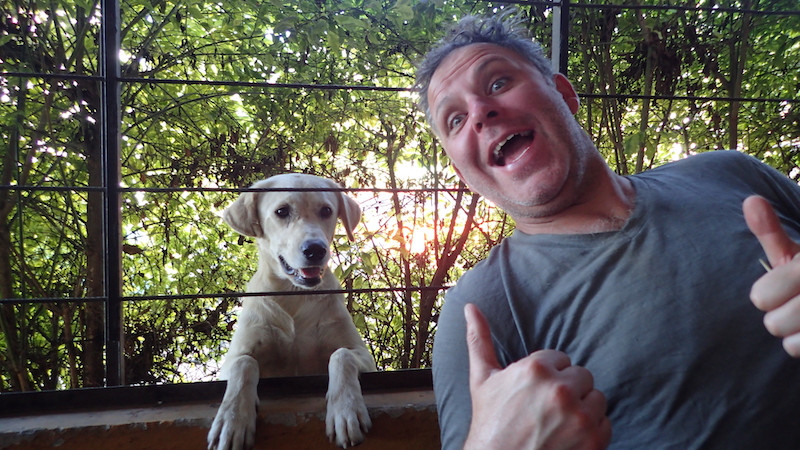 Kelvin with Mr Dog who enjoyed some of our food, Ibague.