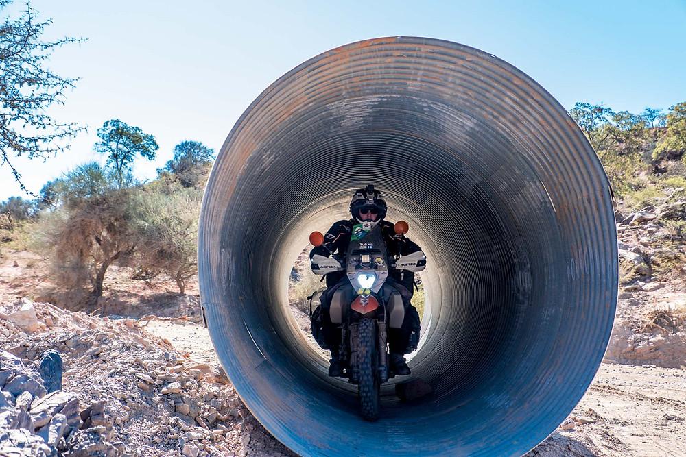 Kelvin having fun in a roadside corrugated tube! - AvVida.co.uk