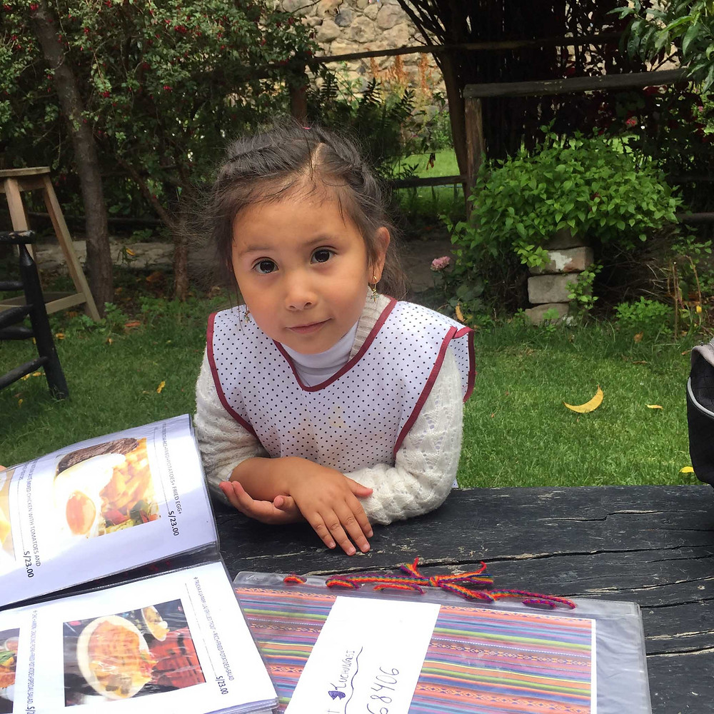 Our dinky, very attentive waitress in Ollaytaytambo.