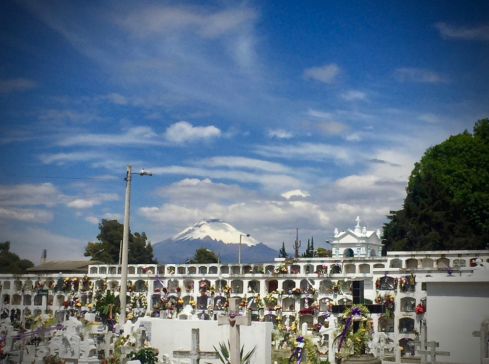 A typical Ecuador cemetry and a view of Cotopaxi.