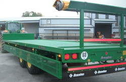 32ft Flat trailer fitted with hydraulic fold-down Platforms