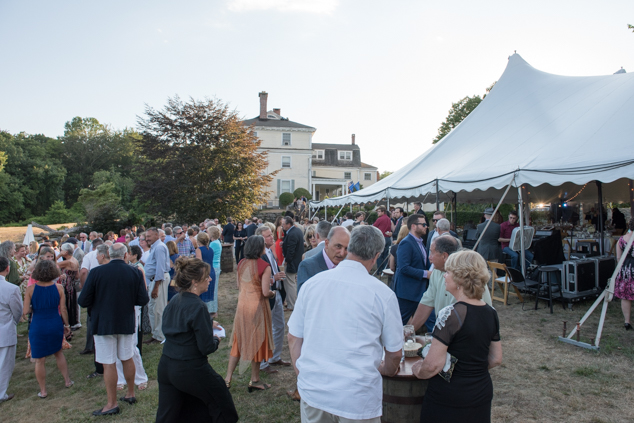 Guests enjoy a formal gala dinner on the grounds of the Sunken Garden.