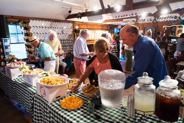 Before a performance, guests enjoy appetizers at a quaint reception in Blue Gene's Pub.