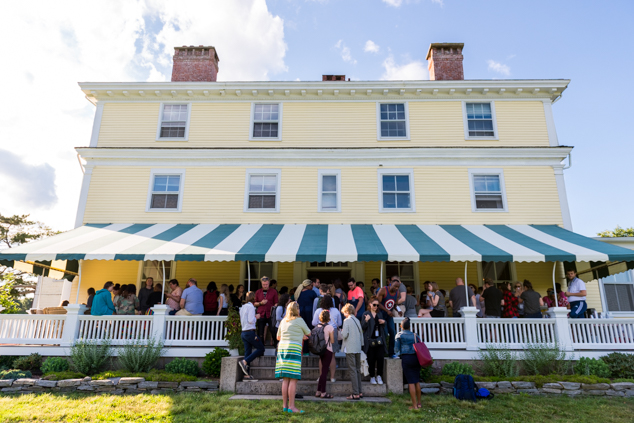 Guests enjoy an outdoor event on the Sea Porch on the back of the Hammond Mansion.