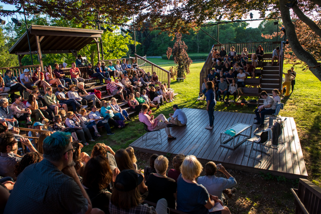 Actors perform on the Edith Oliver Stage underneath the historic beech tree.