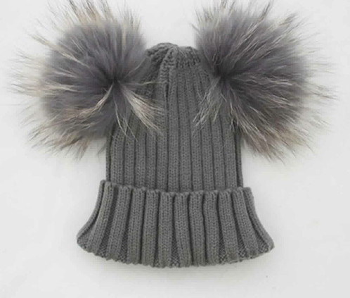 4d73940521a BOYS DARK GREY DOUBLE RACCOON FUR POM POM HAT. £ 20.00. We love this  adorable hat. The oversized fur pom pom will make your little one look very  cute.