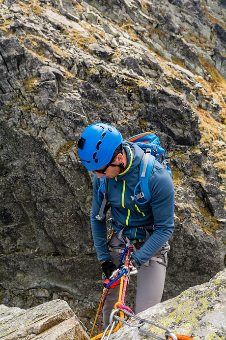 To rappel down a wall. Climber rap down