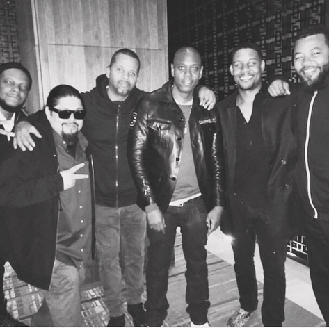 With Dave Chappelle and the crew