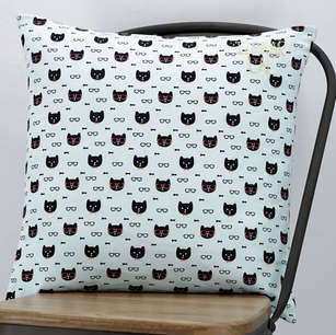 Square cushion in cat print cotton with hand embroidered name on top right corner