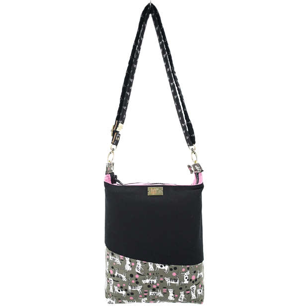 Zippered and reversible bag in black cotton canvas and cat print cotton joined by unique slant feature, can be carried two ways; shoulder tote or crossbody bag