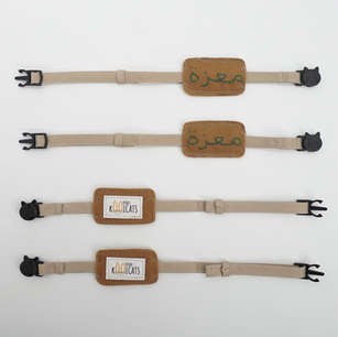 Bulk set of cat collars with hand embroidered names and adjustable lengths