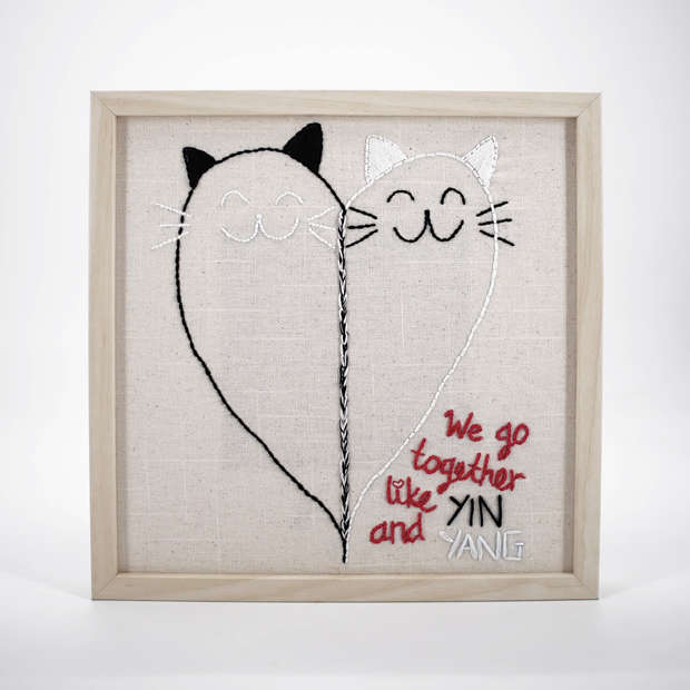 Fully hand embroidered artwork in a frame, featuring two cats intertwined to form a heart