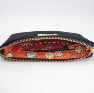 Zippered pouch with cat print lining and inner zippered pocket
