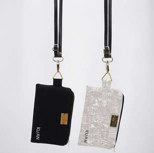 Pair of personalised zippered pouches with detachable and adjustable lanyard