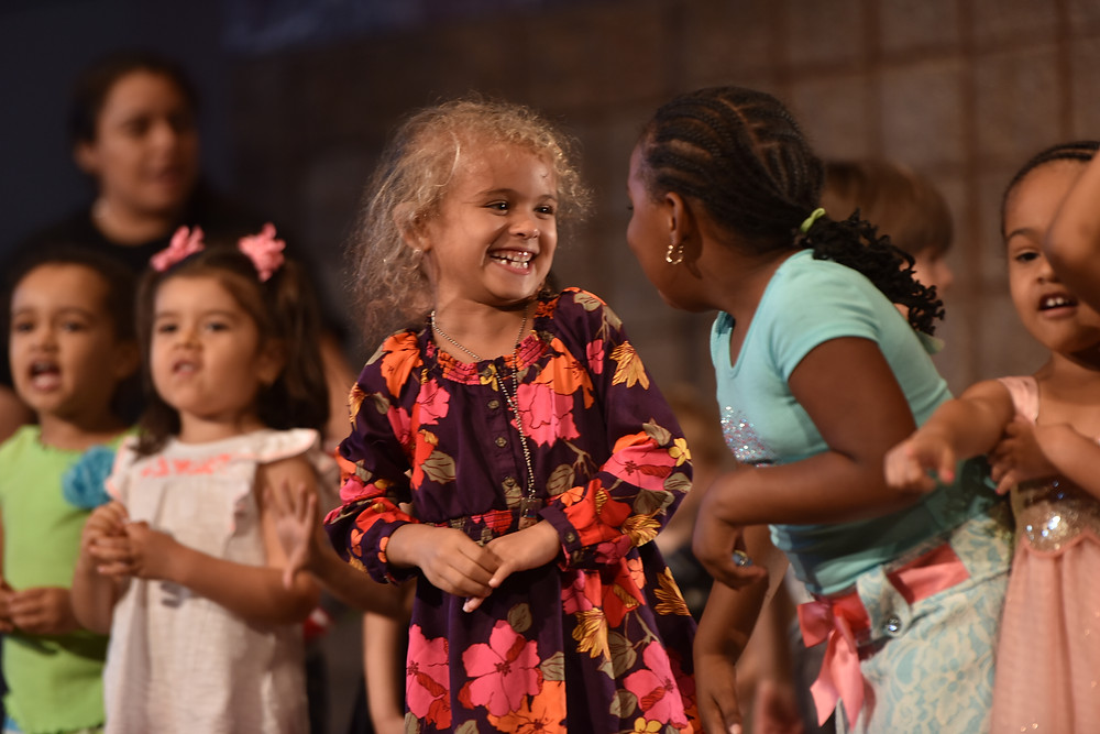 Students enjoy a live performance of a Jemima's Playhouse Experience