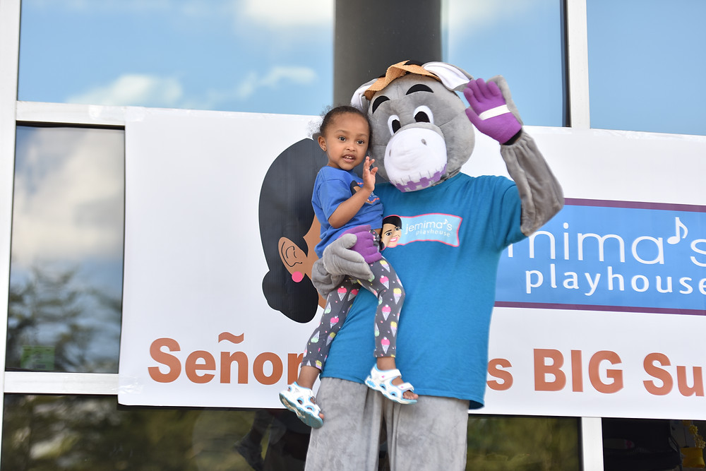 Señor Burro®, a very popular Jemima's Playhouse character, is pictured with an excited student