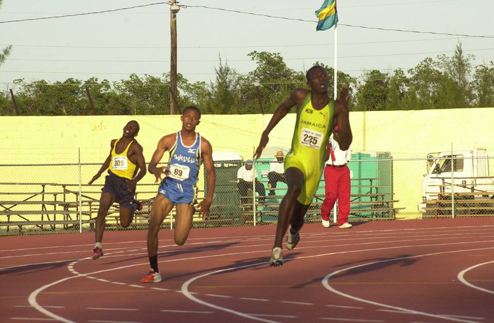 Mr. Tyrone (middle) competes in the Carifta International Track and Field Meet in 2002