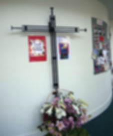 Cross and flowers in Church foyer