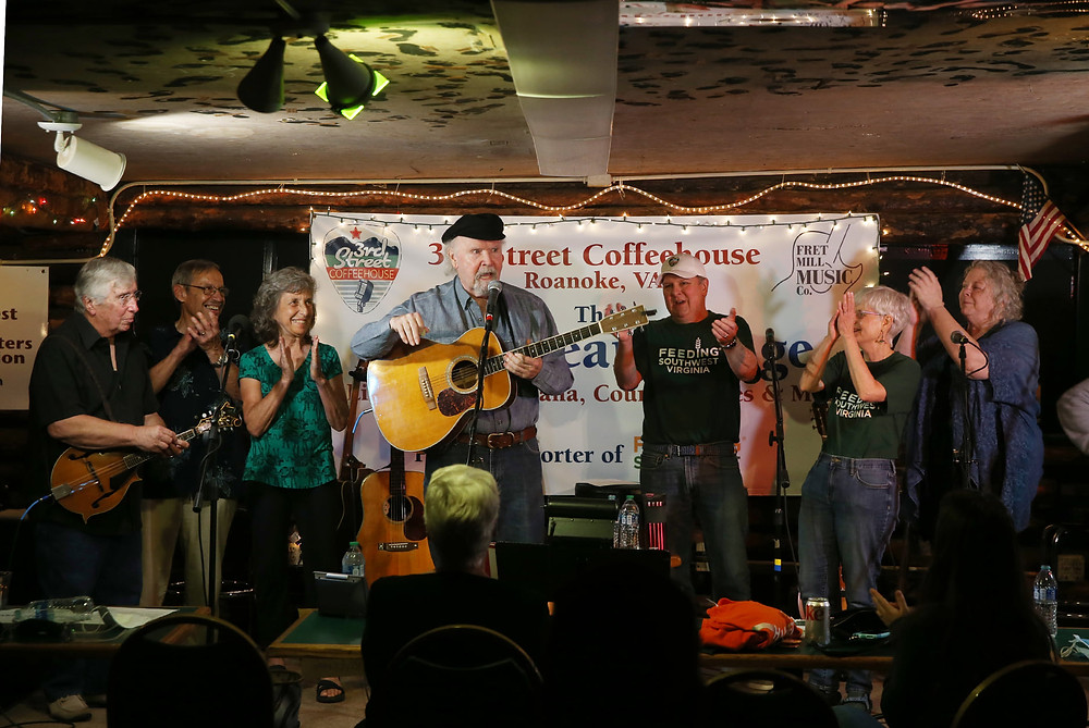 Tom Paxton and other musicians on stage at 3rd Street Coffeehouse