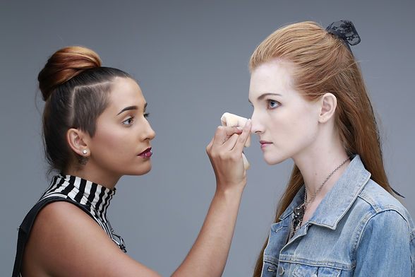 Applying makeup on model for jewelry shoot New York, NY