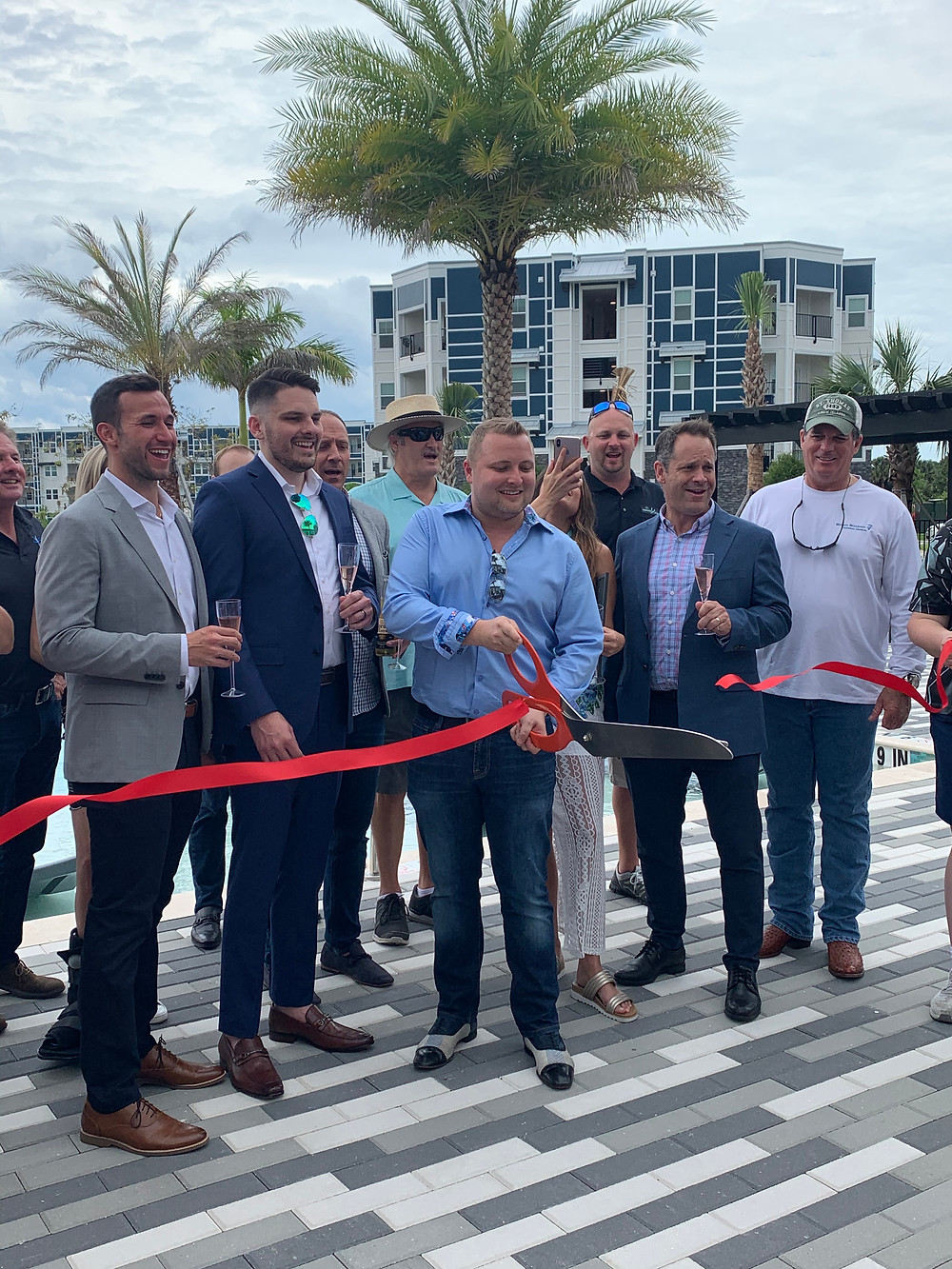 Ribbon Cutting Event by a pool