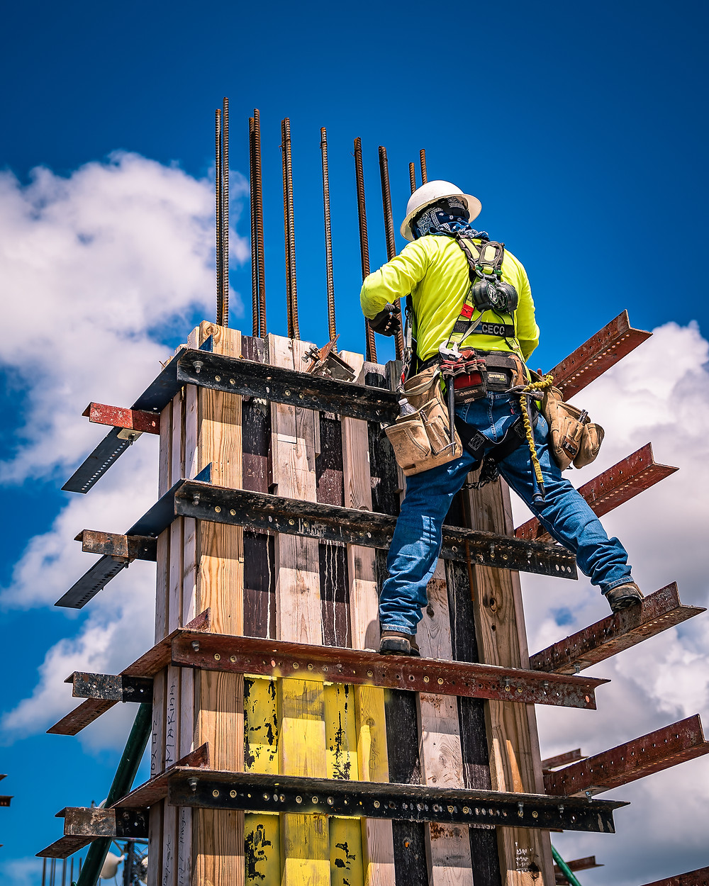 Man with a safety hat - on a scaffolding on a construction jobsite
