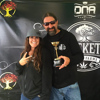 Mr. & Mrs. Crockett posing with one of the many Cannabis Cup awards they've won.